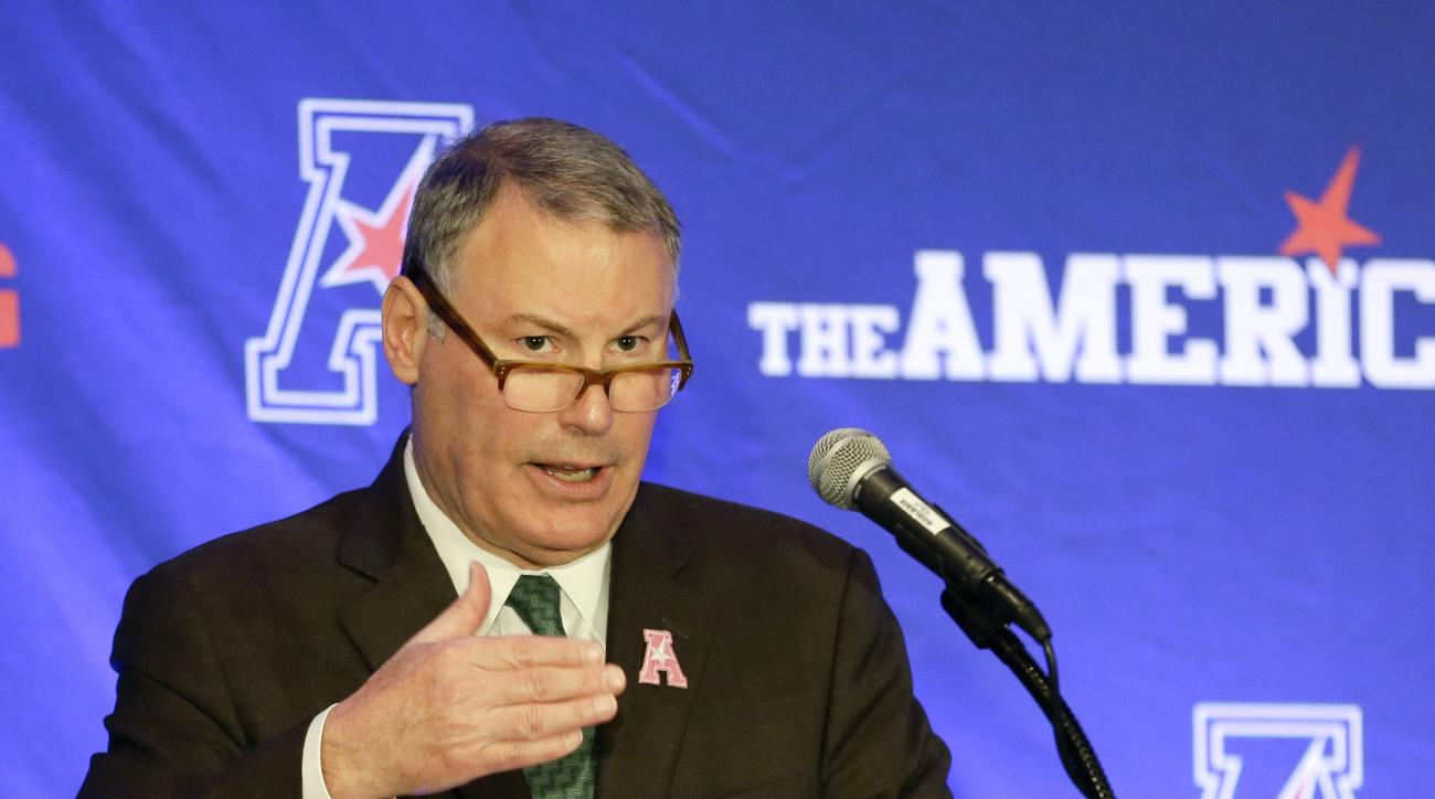 Michael Aresco, commissioner of the American Athletic Conference makes comments during the women's basketball media day, Monday, Oct. 26, 2015, in Orlando, Fla. (AP Photo/John Raoux)
