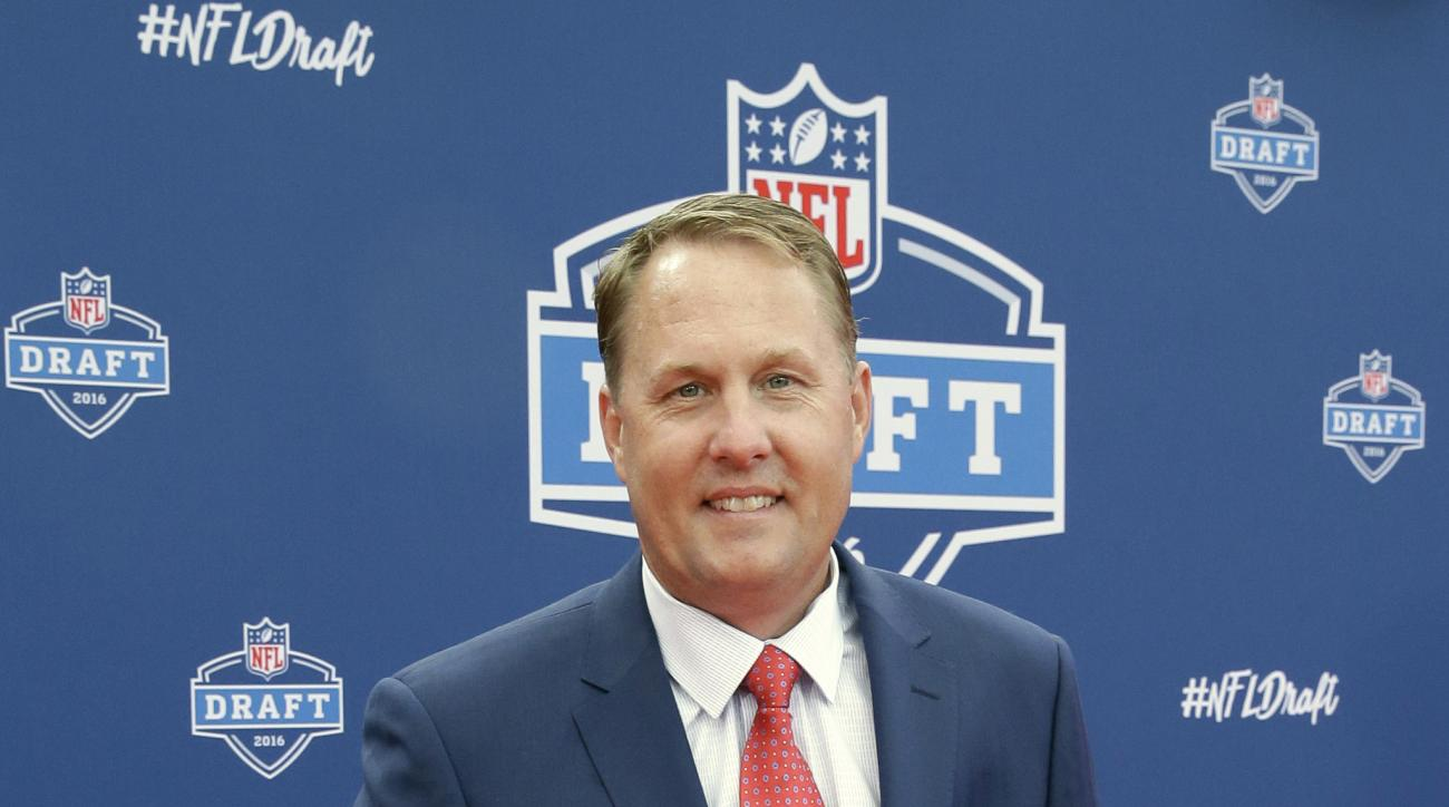 FILE - In this April 28, 2016, file photo, Mississippi head coach Hugh Freeze poses for photos upon arriving for the first round of the 2016 NFL football draft in Chicago. Freeze was surprised by former Rebels offensive lineman Laremy Tunsil's statement a
