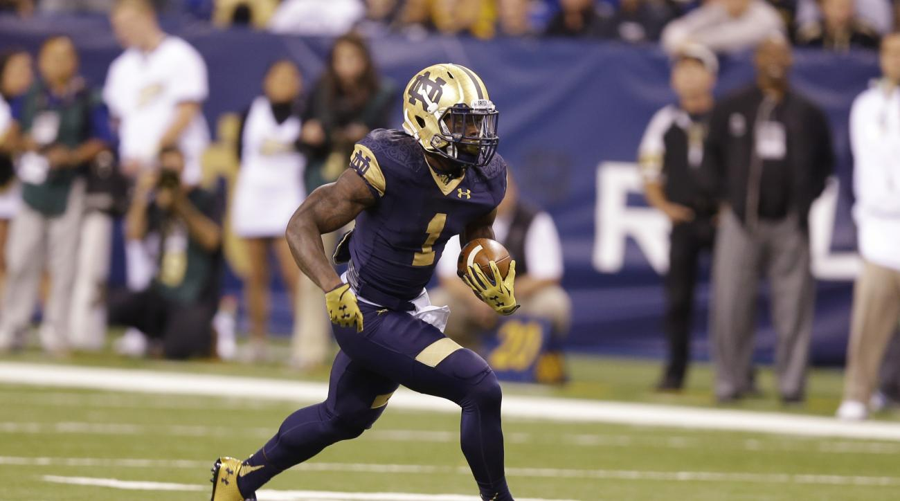 In this Sept. 13, 2014, photo, Notre Dame running back Greg Bryant  runs against Purdue during the first half of an NCAA college football game in Indianapolis. While he is fourth on the team in carries, Bryant leads the eighth-ranked Irish in rushing with