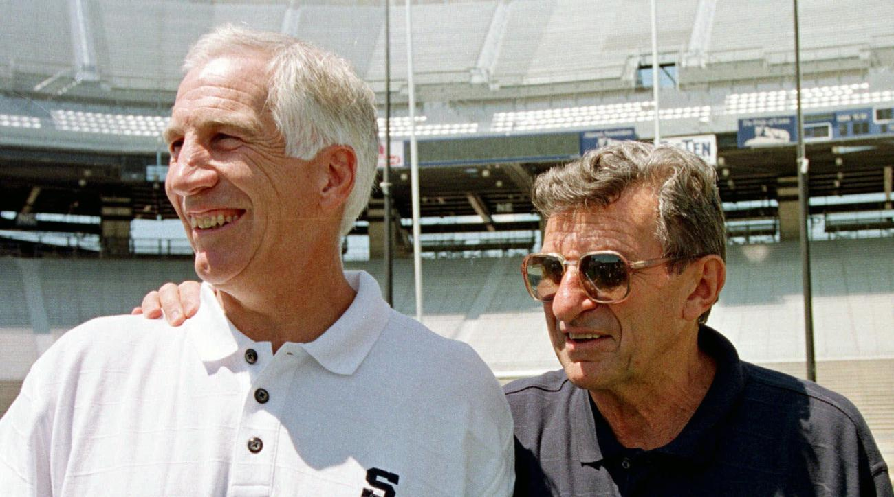 FILE - In this Aug. 6, 1999, file photo, Penn State head football coach Joe Paterno, right, poses with his defensive coordinator Jerry Sandusky during Penn State Media Day at State College, Pa. Penn State President Eric Barron is decrying new allegations