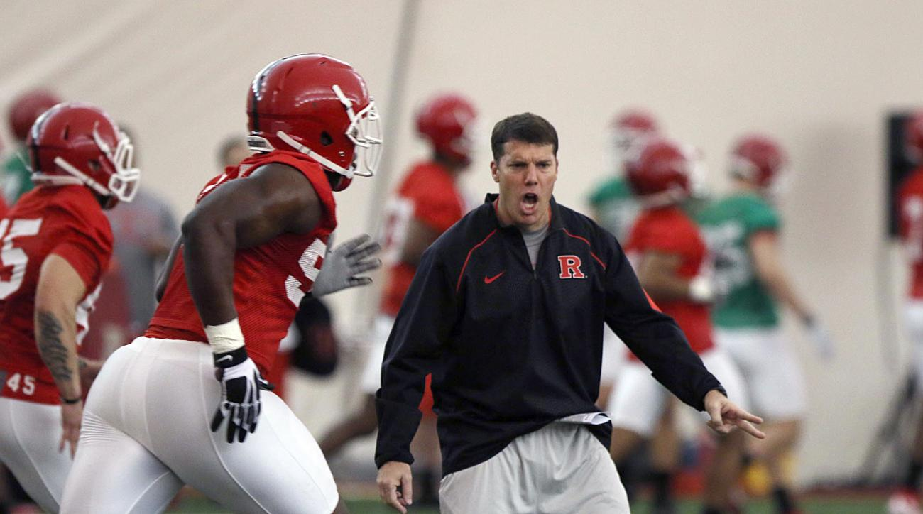 FILE - In this March 24, 2016, file photo, Rutgers NCAA college football coach Chris Ash talks to players during a spring practice in Piscataway, N.J. Even as he climbed the ranks to become the defensive coordinator for a national championship team, Ash s