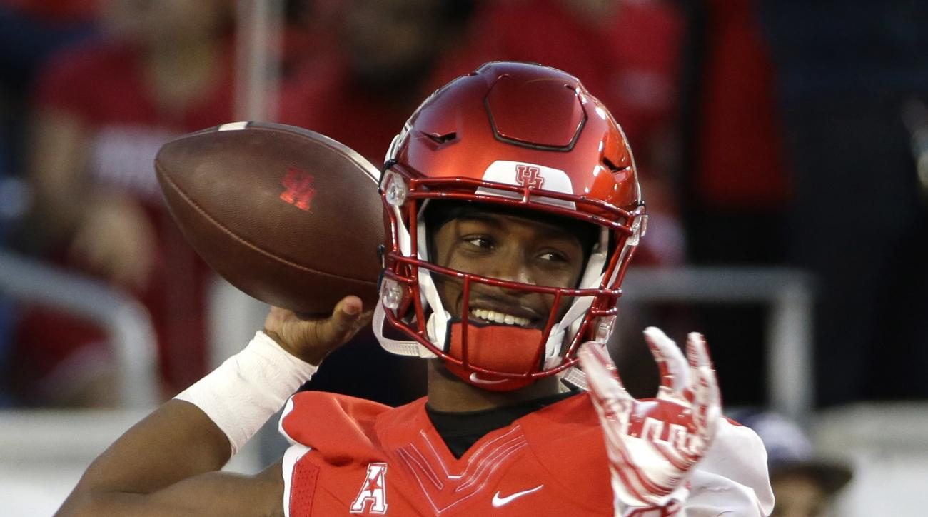 FILe - In this Nov. 14, 2015, file photo, Houston quarterback Greg Ward Jr. (1) warms up before an NCAA college football game against Memphis, in Houston. Cougars coach Tom Herman says Ward must become a more vocal and assertive leader for Houston to matc