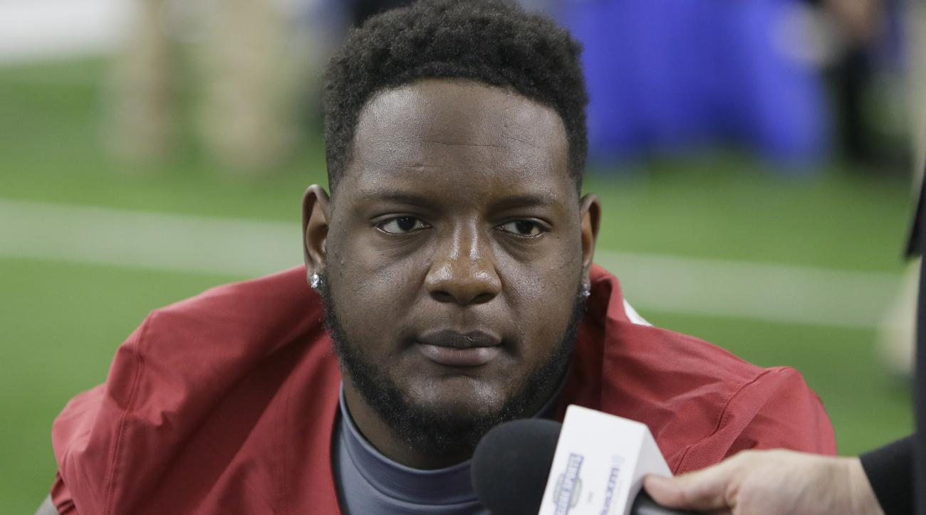Alabama offensive lineman Cam Robinson (74) listens to a question during the media day for the NCAA Cotton Bowl college football game Tuesday, Dec. 29, 2015, in Arlington, Texas. (AP Photo/LM Otero)