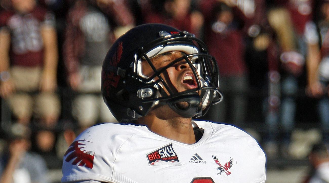 Eastern Washington quarterback Vernon Adams Jr.(3) celebrates after throwing a touchdown pass in the third quarter against Montana in an NCAA college football game in Missoula, Mont., Saturday, Oct. 26, 2013. Eastern Washington beat Montana 42-37. (AP Pho