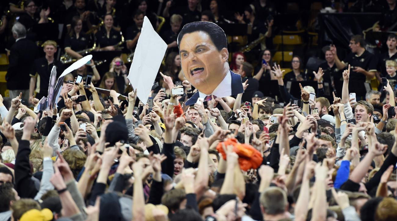 FILE - In this Feb. 24, 2016, file photo, Colorado fans storm the court after Colorado defeated Arizona 75-72 in an NCAA college basketball game in Boulder, Colo. The Pac-12 CEO Group on Tuesday, May 24,2 016,  has approved provisions to reduce night foot