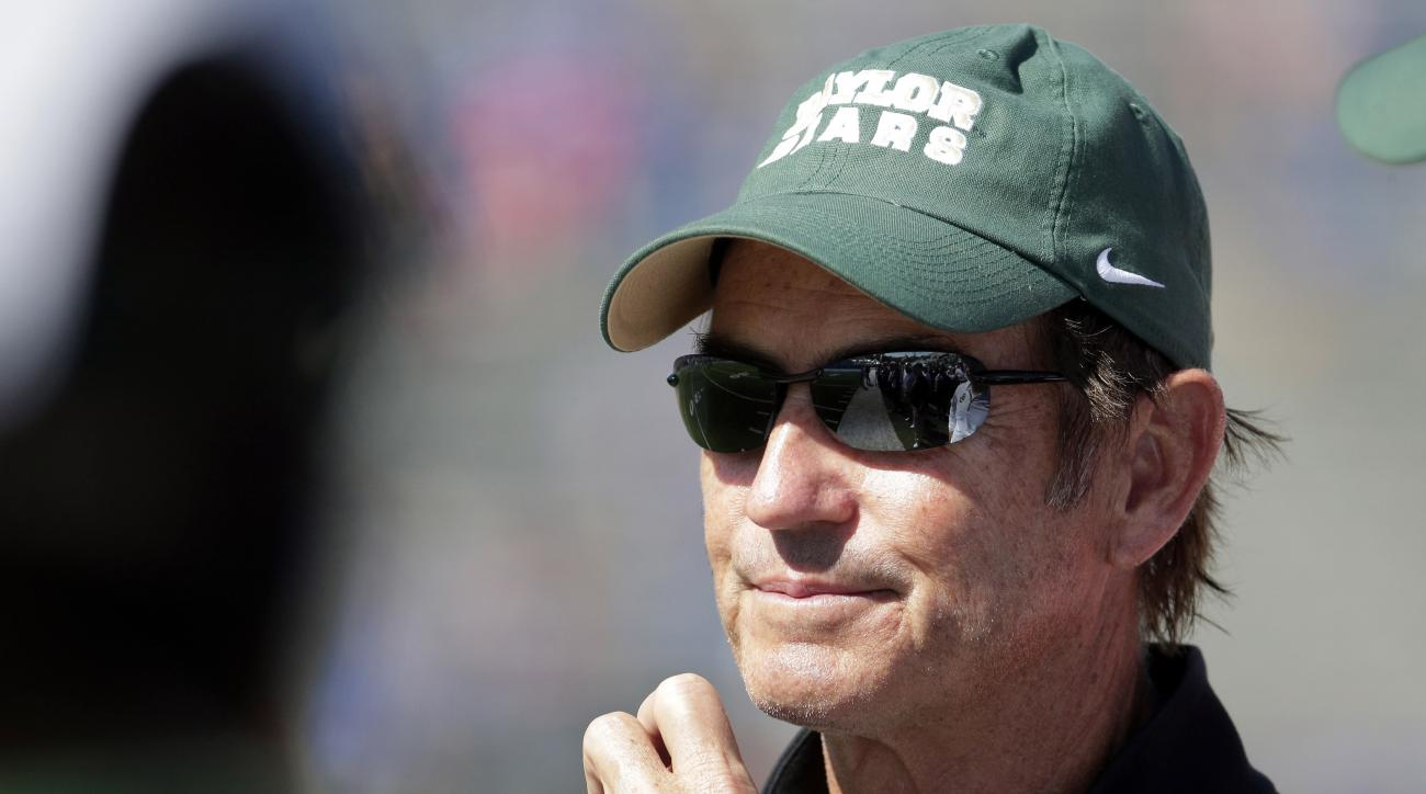 FILE - In this Oct. 10, 2015, file photo, Baylor head coach Art Briles watches during the second half of an NCAA college football game against Kansas in Lawrence, Kan. Baylor University's board of regents says it will fire Briles and re-assign university