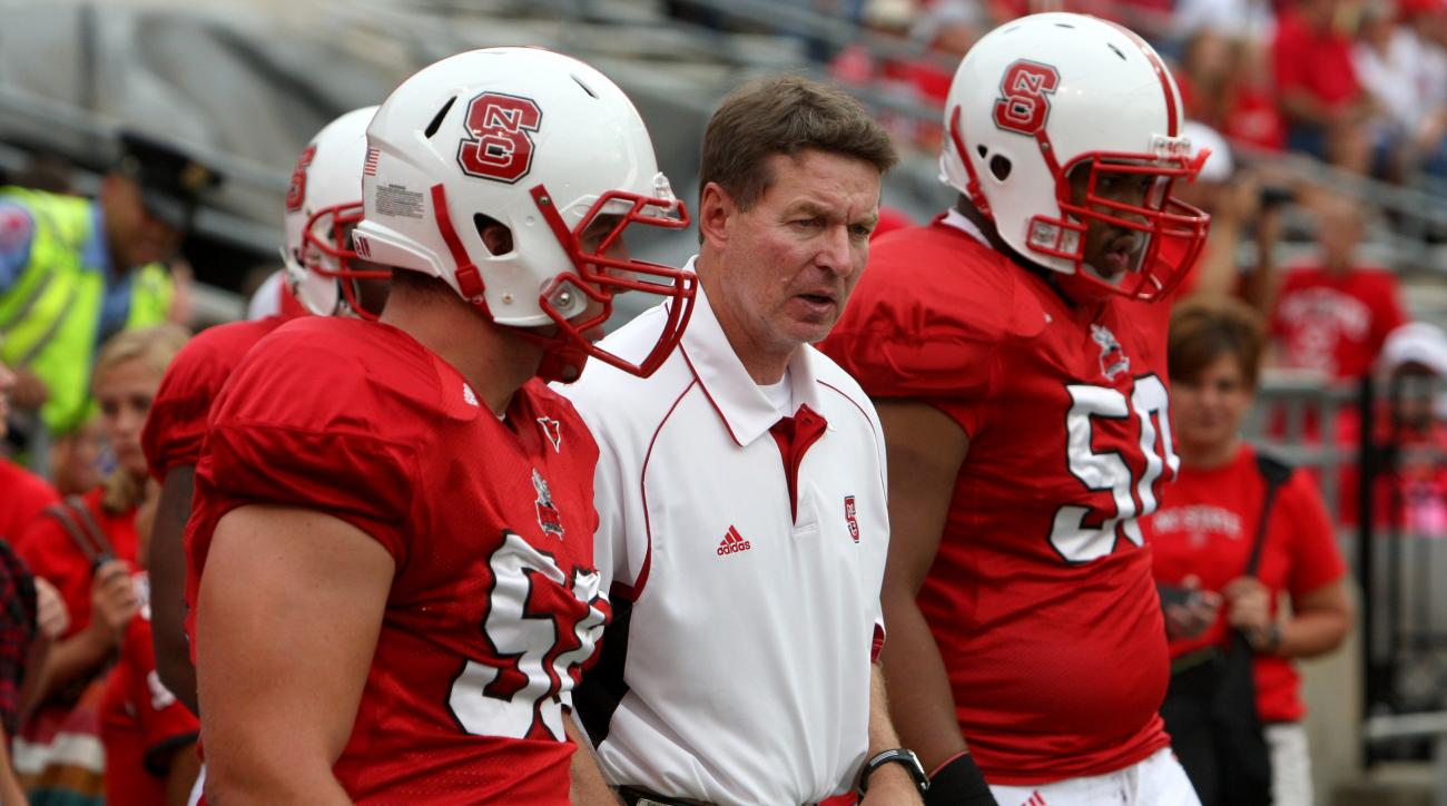 In this photo taken Sept. 19, 2009, North Carolina State assistant coach Don Horton works directs players before an NCAA college football game against Gardner-Webb at Carter-Finley Stadium in Raleigh, N.C. Horton, a former North Carolina State and Boston
