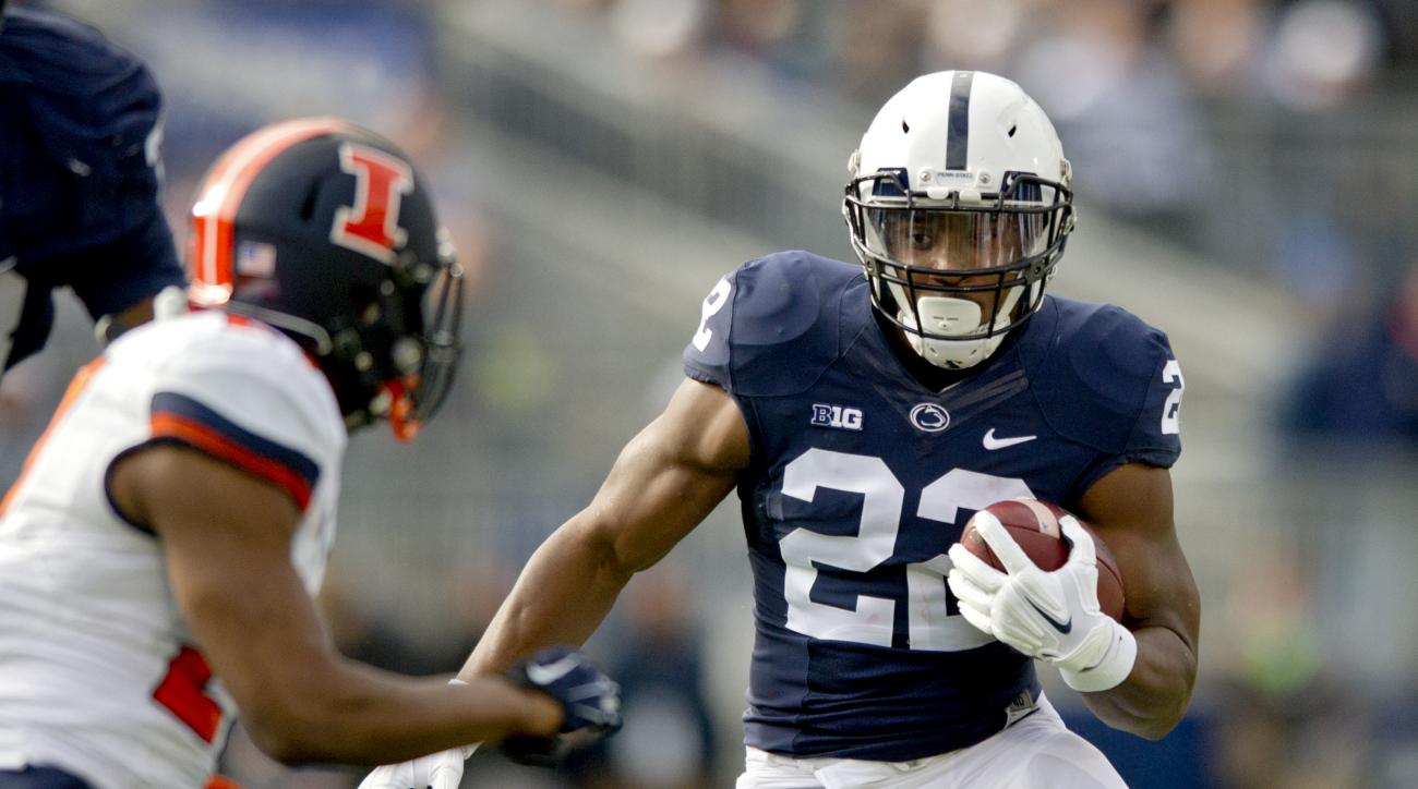 FILE - In this Oct. 31, 2015, file photo, Penn State running back Akeel Lynch cuts down the field with the ball from Illinois defenders at Beaver Stadium in State College, Pa. Facing the prospect of spending most of his final season of college eligibility