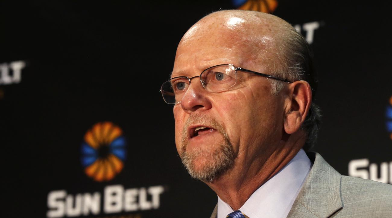 FILE - In this July 22, 2014 file photo, Sun Belt Commissioner Karl Benson talks during the Sun Belt media day in New Orleans. The Sun Belt Conference has lost a member and gained four new ones since last season. Unchanged are the expectations for defendi