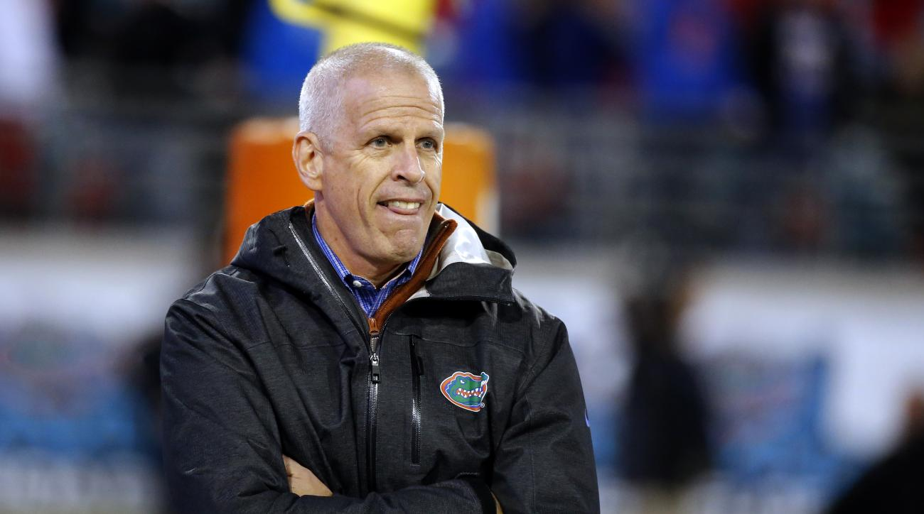 FILE - In this Nov. 1, 2014, file photo, Florida Athletic Director Jeremy Foley walks on the sidelines during the second half of an NCAA college football game between Florida and Georgia in Jacksonville, Fla. Florida athletic director Jeremy Foley has twi