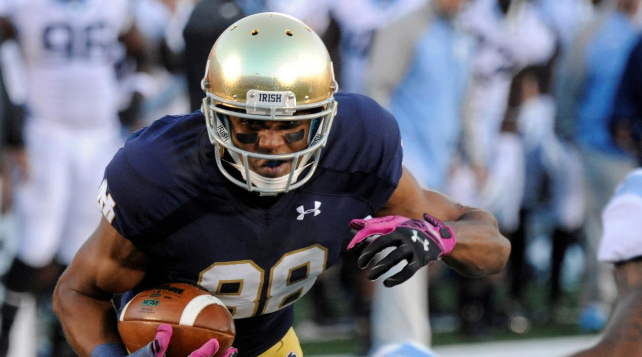 FILE - In this Oct. 11, 2014, file photo, Notre Dame wide receiver Corey Robinson makes a catch during an NCAA college football game against North Carolina in South Bend, Ind. Robinson has decided to walk away from football because of the lingering effect