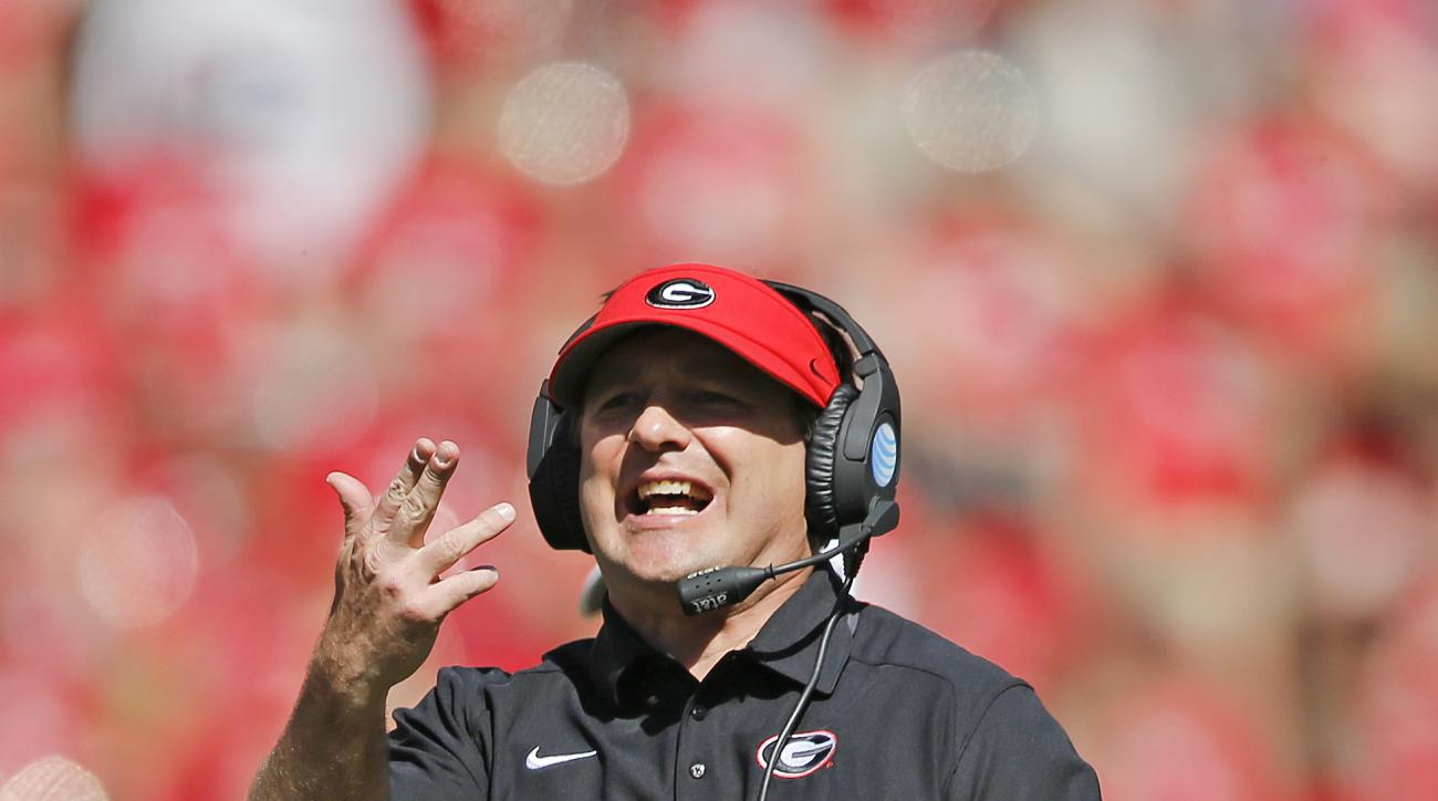 Georgia coach Kirby Smart signals to his players during the first half of a spring NCAA college football game Saturday, April 16, 2016, in Athens, Ga. (AP Photo/John Bazemore)