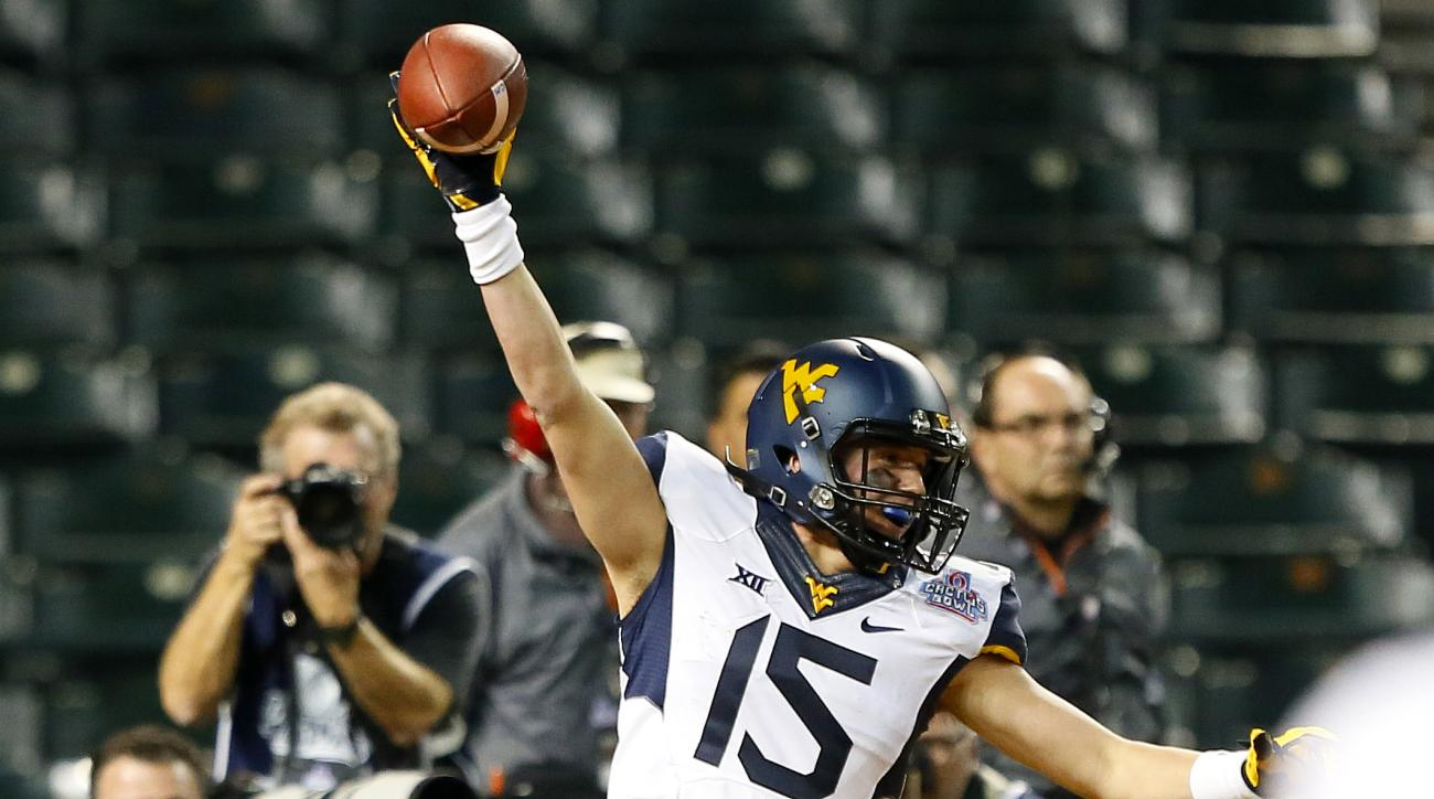 West Virginia wide receiver David Sills (15) celebrates the game winning touchdown during the second half of the Cactus Bowl NCAA college football game against Arizona State, Sunday, Jan. 3, 2016, in Phoenix. West Virginia won 43-42. (AP Photo/Matt York)