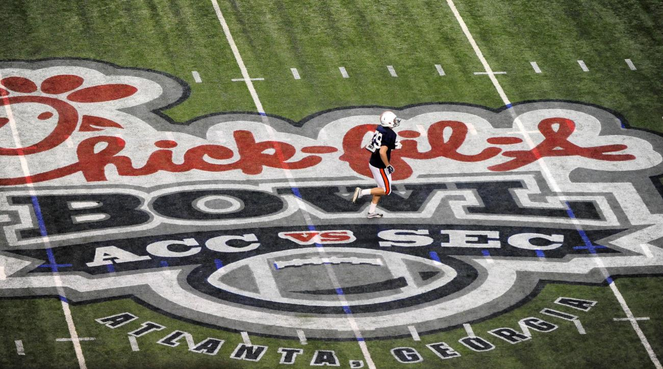 Auburn kicker Chandler Brooks (29) runs past the official Chick-fil-A Bowl logo at midfield during an NCAA football practice at the Georgia Dome on Tuesday, Dec. 27, 2011, in Atlanta. Virginia will face Auburn for the 44th annual Chick-fil-A Bowl on Satur