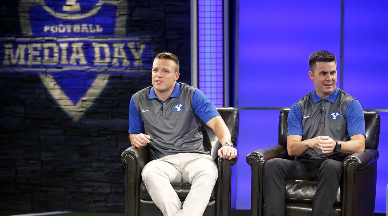 BYU quarterback's Tayson Hill, left, and Tanner Mangum speak at an interview during NCAA college football media day Thursday, June 30, 2016, in Provo, Utah. (AP Photo/Rick Bowmer)