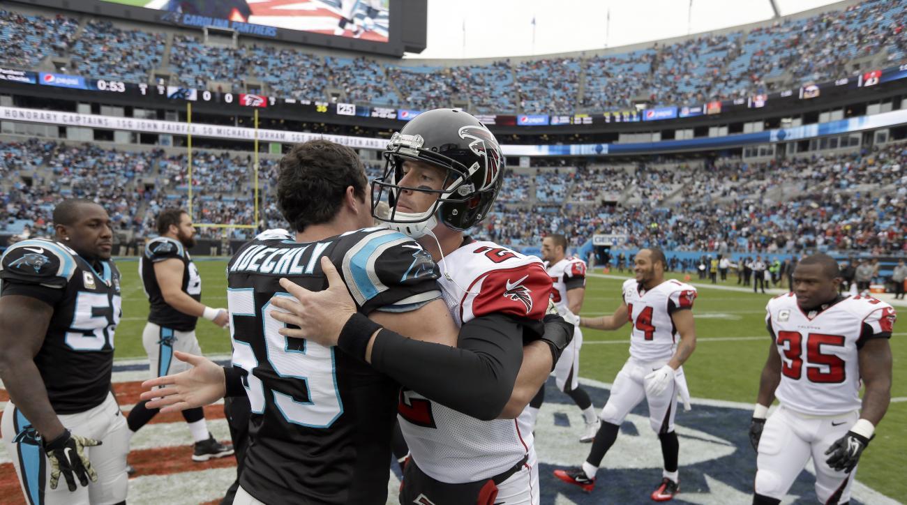 Carolina Panthers' Luke Kuechly (59) greets Atlanta Falcons' Matt Ryan (2) at midfield before an NFL football game in Charlotte, N.C., Sunday, Nov. 16, 2014. The Falcons won 19-17. (AP Photo/Bob Leverone)