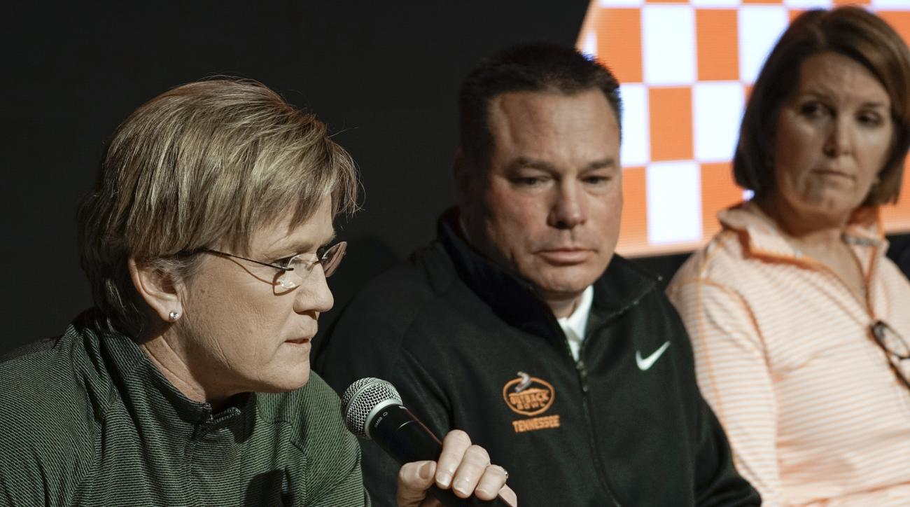 Tennessee women's basketball coach Holly Warlick, left, speaks during a news conference Tuesday, Feb. 23, 2016, in Knoxville, Tenn. The school's coaches held a news conference two weeks after a group of unidentified women sued the school over its handling