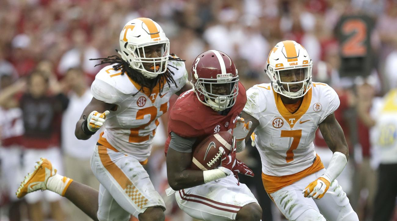 FILE -- In this Oct. 24, 2015, file photo, Tennessee linebacker Jalen Reeves-Maybin (21) and defensive back Cameron Sutton (7) close in on Alabama wide receiver Calvin Ridley (3) in an NCAA college football game, Saturday, Oct. 24, 2015, in Tuscaloosa, Al