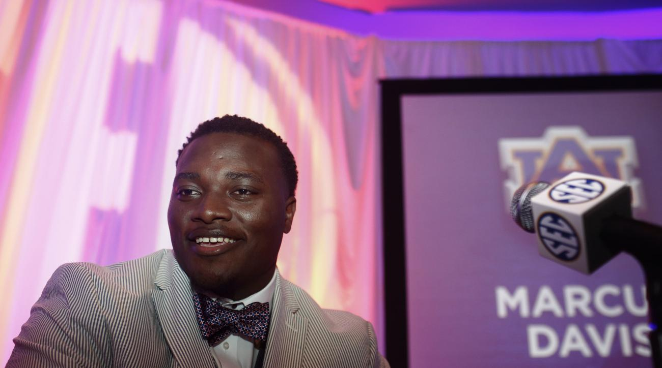 Auburn defensive lineman Montravius Adams speaks to the media at the Southeastern Conference NCAA college football media days, Monday, July 11, 2016, in Hoover, Ala. (AP Photo/Brynn Anderson)