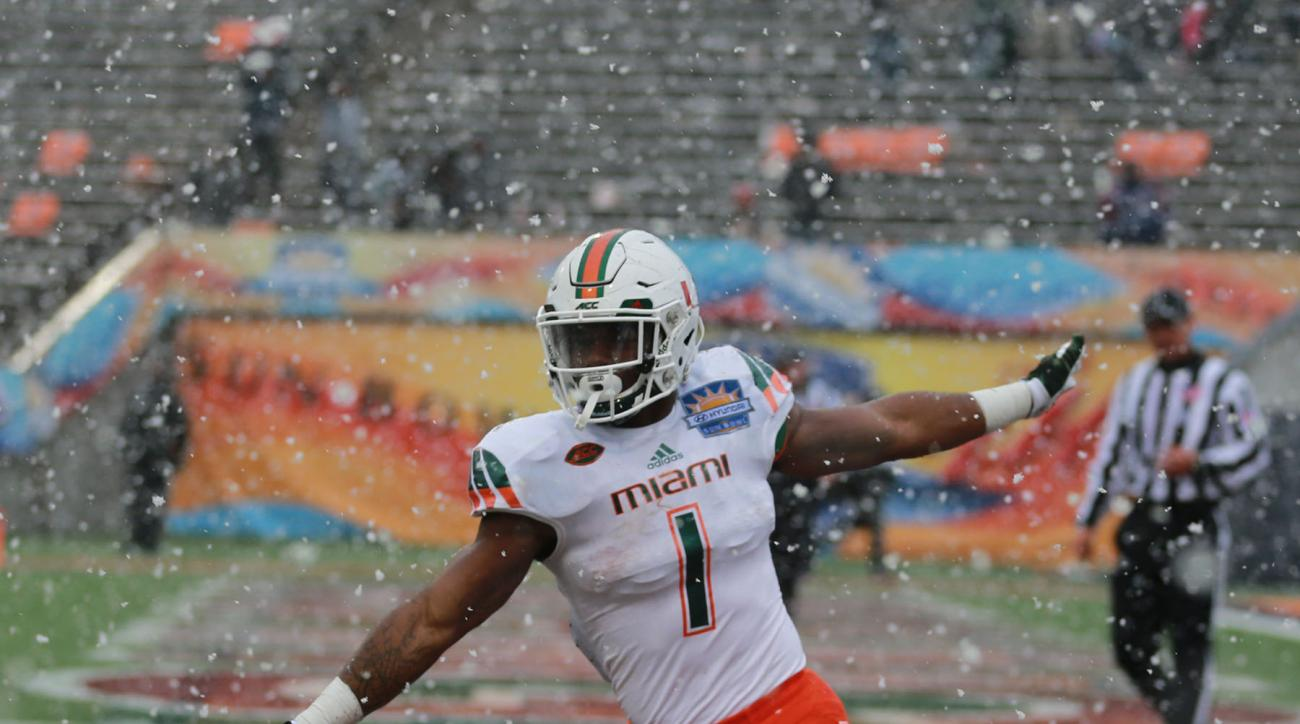 Miamis Mark Walton celebrates his touchdown as snow falls during the fourth quarter of the Sun Bowl NCAA college football game against Washington State, Saturday, Dec. 26, 2015, in El Paso, Texas. (AP Photo/Victor Calzada)