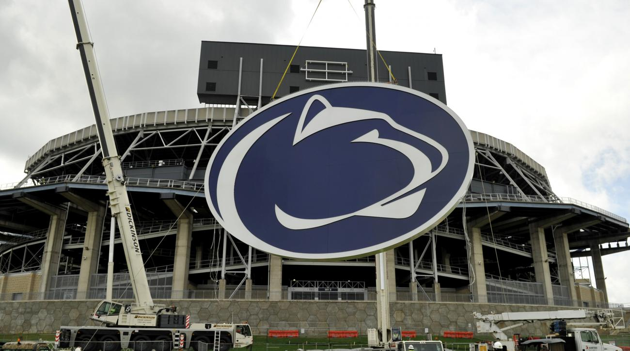 FILE - In this May 15, 2014 file photo, a logo is lifted by crane to the back of a scoreboard at Penn State's Beaver Stadium in State College, Pa.   Judge Gary Glazer is expected to release records Tuesday, July 12, 2016, that also may contain details abo