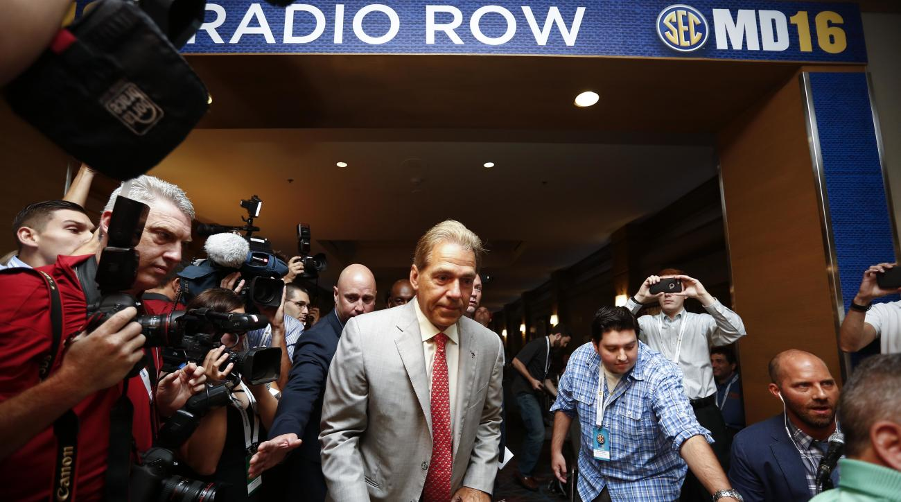 Alabama coach Nick Saban walks into radio row before he speaks to the media at the Southeastern Conference NCAA college football media days, Wednesday, July 13, 2016, in Hoover, Ala. (AP Photo/Brynn Anderson)