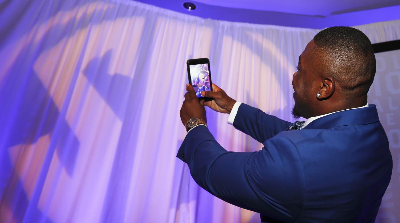 Kentucky running back Jojo Kemp takes a selfie with the media before he speaks at the Southeastern Conference NCAA college football media days, Wednesday, July 13, 2016, in Hoover, Ala. (AP Photo/Brynn Anderson)