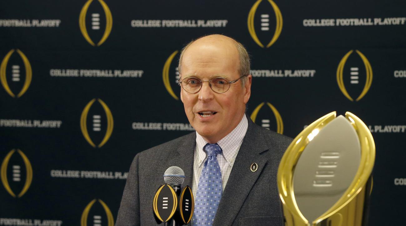 """FILE - This is a Nov. 4, 2015, file photo showing College Football Playoff executive director Bill Hancock speaks during a press conference, in Rosemont, Ill. Hancock said Tuesday, March 22, 2016, that it's still """"too soon to say"""" if any other adjustments"""