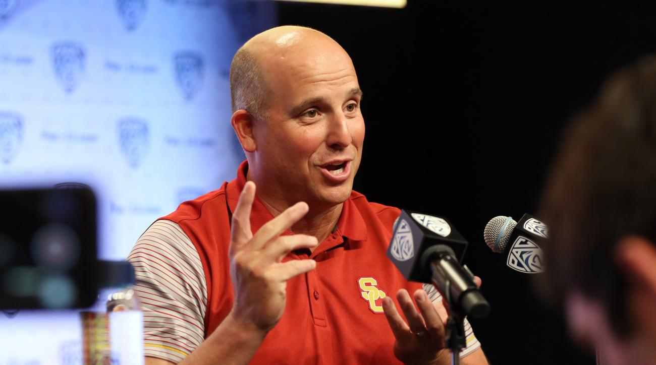 USC head coach Clay Helton talks about 'juggling' several roles during his time at USC as he speaks to reporters at the Pac-12 NCAA college football media day in Los Angeles Thursday, July 14, 2016. (AP Photo/Reed Saxon)