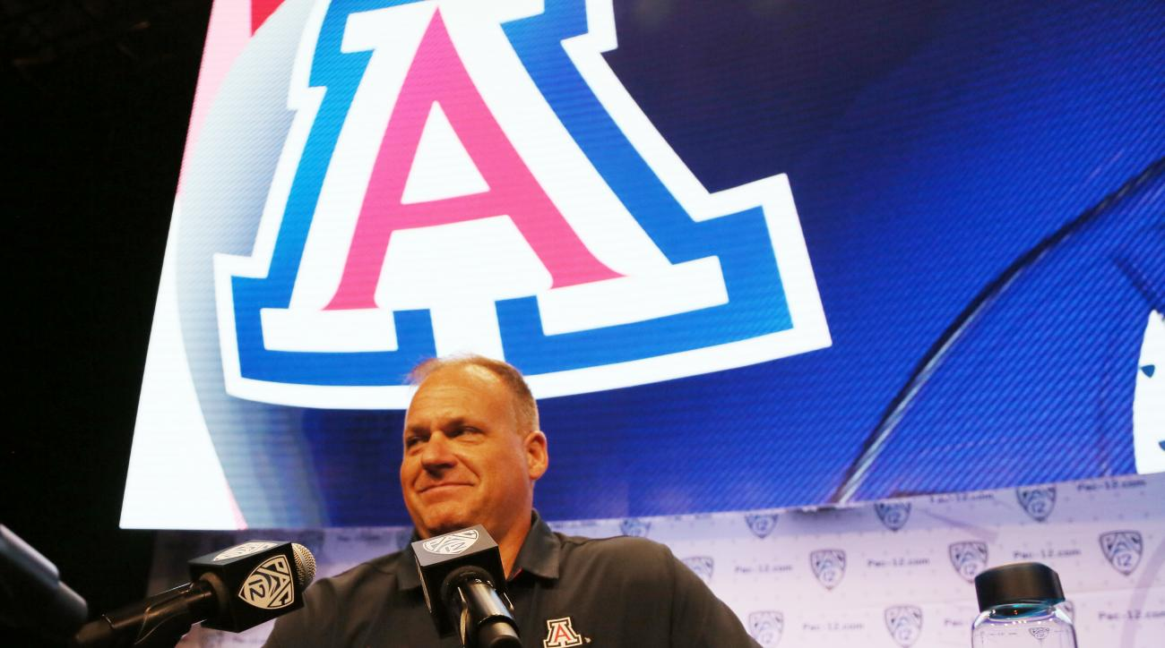 Arizona head coach Rich Rodriguez talks with reporters at the Pac-12 NCAA college football media day in Los Angeles Thursday, July 14, 2016. (AP Photo/Reed Saxon)