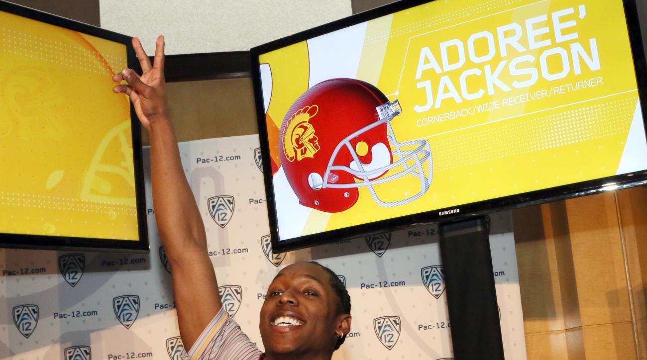 "Southern California's Adoree' Jackson flashes a 'V"" sign as he sees coach Clay Helton at the Pac-12 NCAA college football media day in Los Angeles Thursday, July 14, 2016. Jackson is back from a seven-month break from football while he tried to qualify fo"