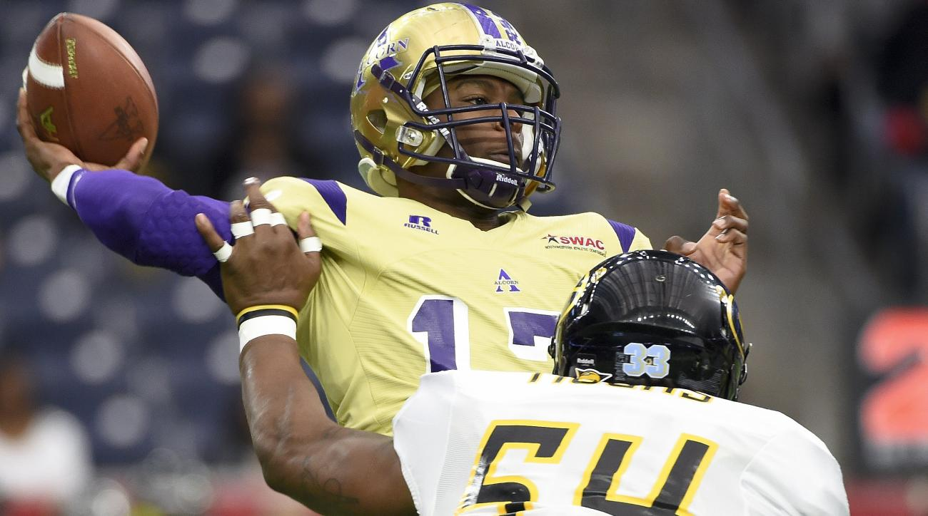 Alcorn State quarterback Lenorris Footman (17) throws a pas as Grambling State linebacker Arkez Cooper (54) applies pressure in the first quarter of the Southwestern Athletic Conference championship college football game, Saturday, Dec. 5, 2015, in Housto