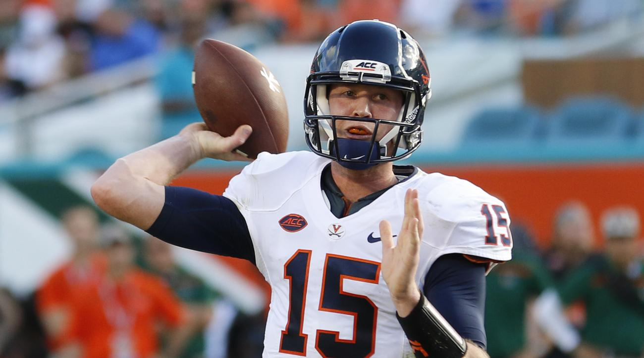 FILE - In this Nov. 7, 2015, file photo, Virginia quarterback Matt Johns throws against Miami in the first half of an NCAA college football game in Miami Gardens, Fla. In a summer that marks the start of a new era for the Cavaliers, the fifth-year senior
