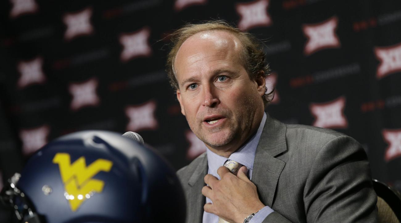 West Virginia head coach Dana Holgorsen speaks to reporters during the Big 12 college football media days in Dallas, Tuesday, July 19, 2016. (AP Photo/LM Otero)