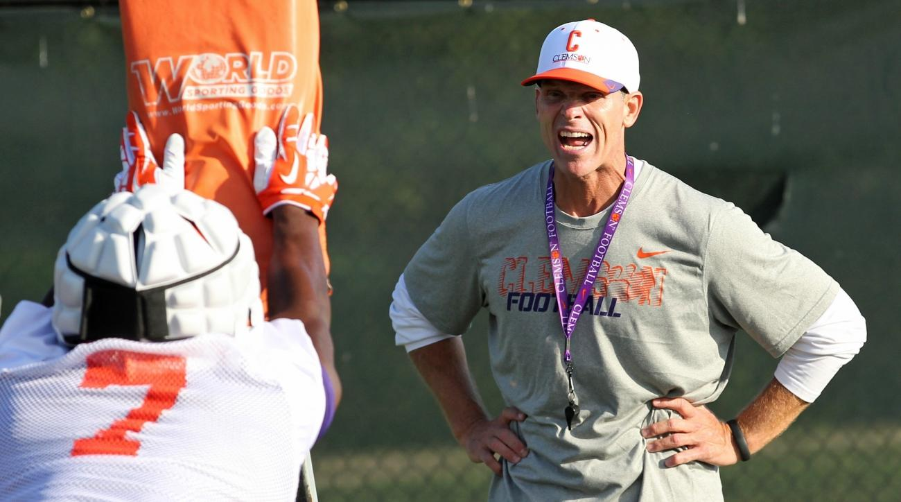 FILE - In this Aug. 1, 2014, file photo, Clemson defensive coordinator Brent Venables yells at linebacker Tony Steward during a drill at the team's opening NCAA college football practice of the season, in Clemson, S.C. It's become an all too familiar scen
