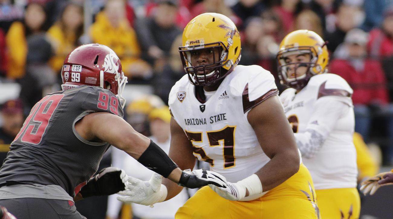 FILE - In this Nov. 7, 2015, file photo, Arizona State offensive lineman Evan Goodman (57) prepares to block Washington State defensive lineman Darryl Paulo (99) during the second half of an NCAA college football game in Pullman, Wash.  Goodman came to Te