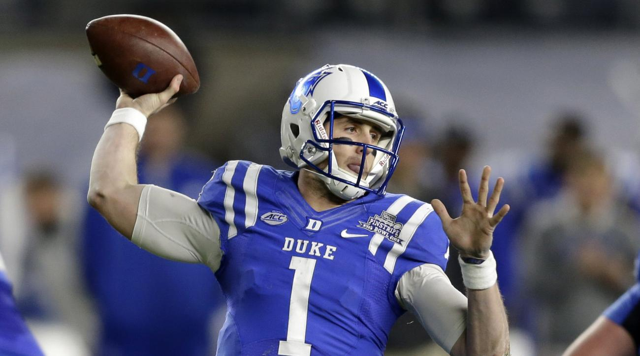 FILE - In this Dec. 26, 2015, file photo, Duke quarterback Thomas Sirk looks to throw during the first half of the Pinstripe Bowl NCAA college football game against Indiana at Yankee Stadium in New York. Sirk has already come back from one ruptured Achill