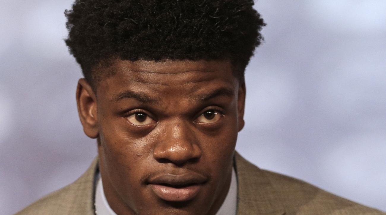 Louisville's Lamar Jackson answers a question during a news conference at the Atlantic Coast Conference Football Kickoff in Charlotte, N.C., Friday, July 22, 2016. (AP Photo/Chuck Burton)