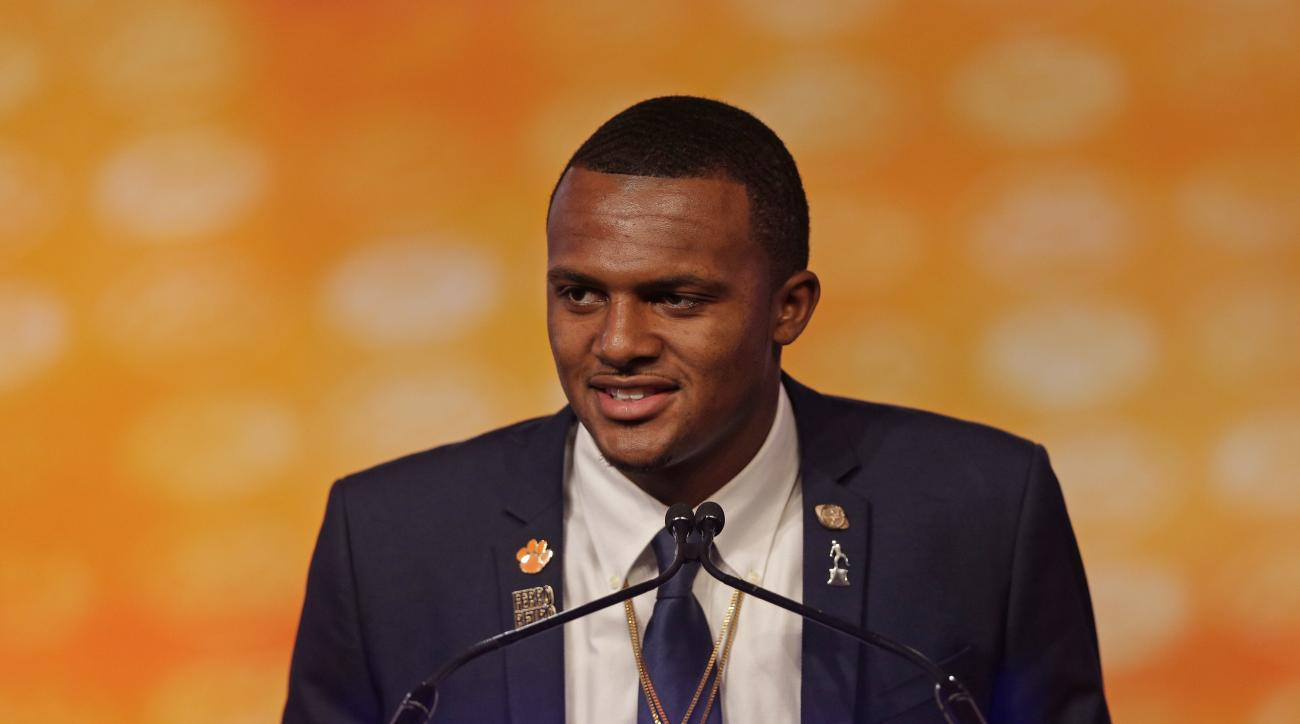 Clemson's Deshaun Watson answers a question during a news conference at the Atlantic Coast Conference Football Kickoff in Charlotte, N.C., Friday, July 22, 2016. (AP Photo/Chuck Burton)