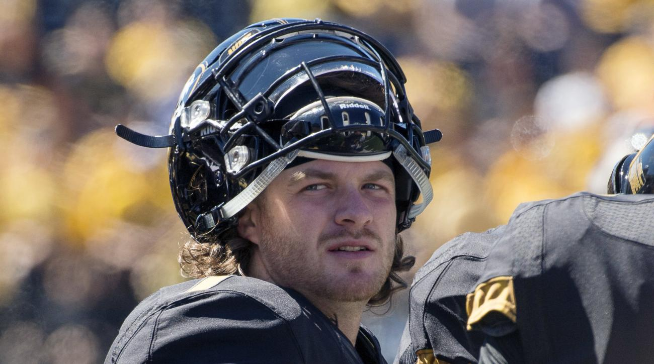 FILE - In this Sept. 19, 2015, file photo, Missouri quarterback Maty Mauk watches from the sideline as his team plays Connecticut in the second quarter of an NCAA college football game in Columbia, Mo. Mauk understands that second-guessing might accompany