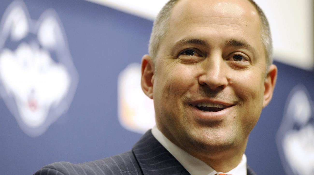 David Benedict speaks to the media during a news conference where he was introduced as the University of Connecticut's new athletic director, Tuesday, March 1, 2016, in Storrs, Conn. (AP Photo/Jessica Hill)