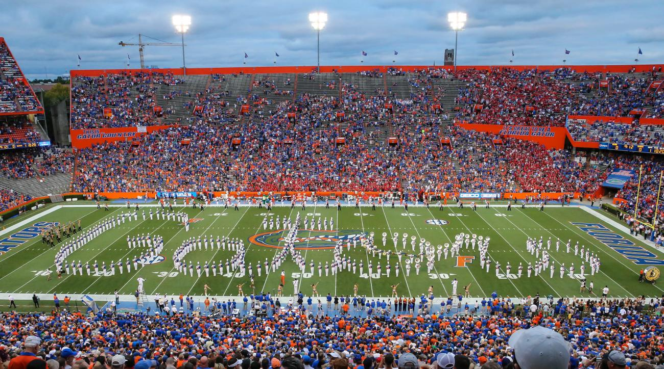 The Florida marching band spells out Gators before an NCAA college football game against Mississippi Saturday, Oct. 3, 2015, in Gainesville, Fla. (AP Photo/Gary McCullough)