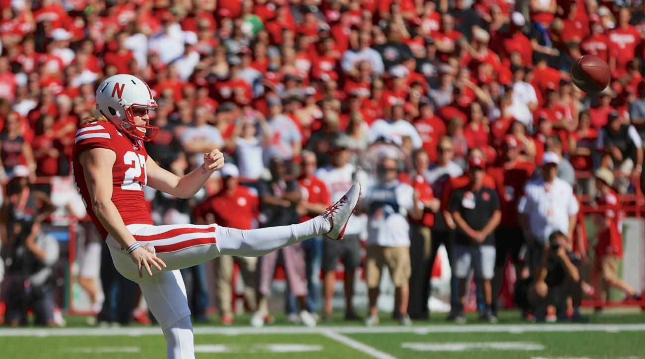 Nebraska punter Sam Foltz (27) punts during the first half of an NCAA college football game against Wisconsin in Lincoln, Neb., Saturday, Oct. 10, 2015. (AP Photo/Nati Harnik)