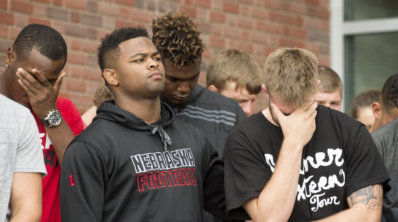 Nebraska football players attend a vigil for Nebraska punter Sam Foltz, Sunday, July 24, 2016, in Lincoln, Neb. Foltz and former Michigan State punter Mike Sadler died in a car crash in Wisconsin after working at a kicking clinic, a sheriff's department o