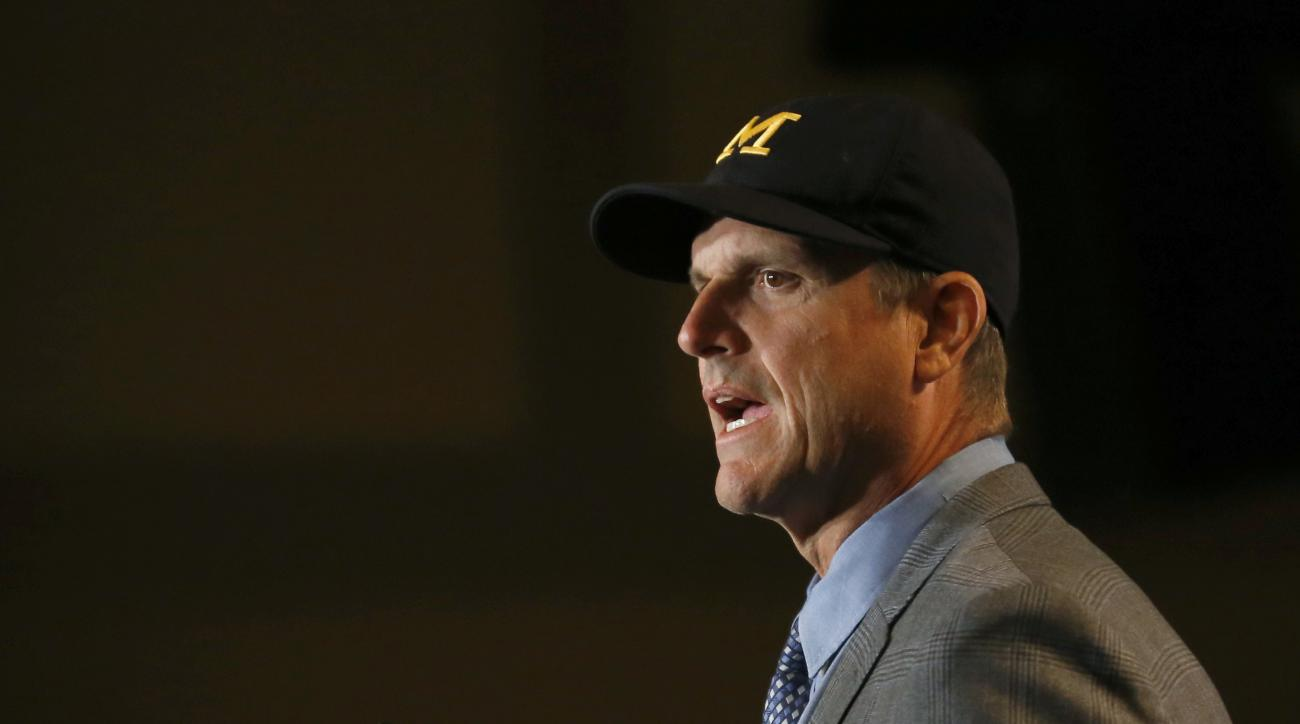 Michigan head coach Jim Harbaugh speaks to the media at the Big Ten NCAA college football media days, Monday, July 25, 2016 in Chicago. (AP Photo/Tae-Gyun Kim)
