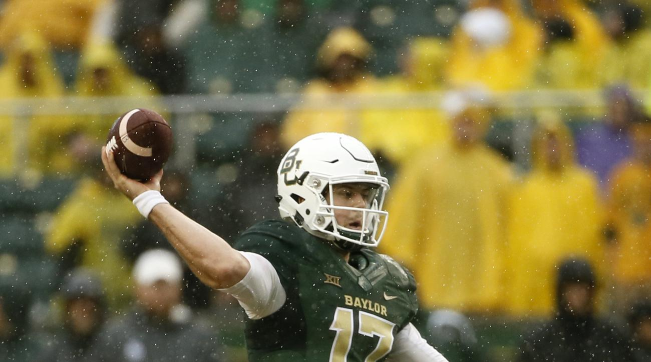 FILE - In this Oct. 24, 2015, file photo, Baylor quarterback Seth Russell throws during an NCAA college football game against Iowa State in Waco, Texas. Russell is coming off neck surgery that ended his 2015 season just as he was starting to get rolling (