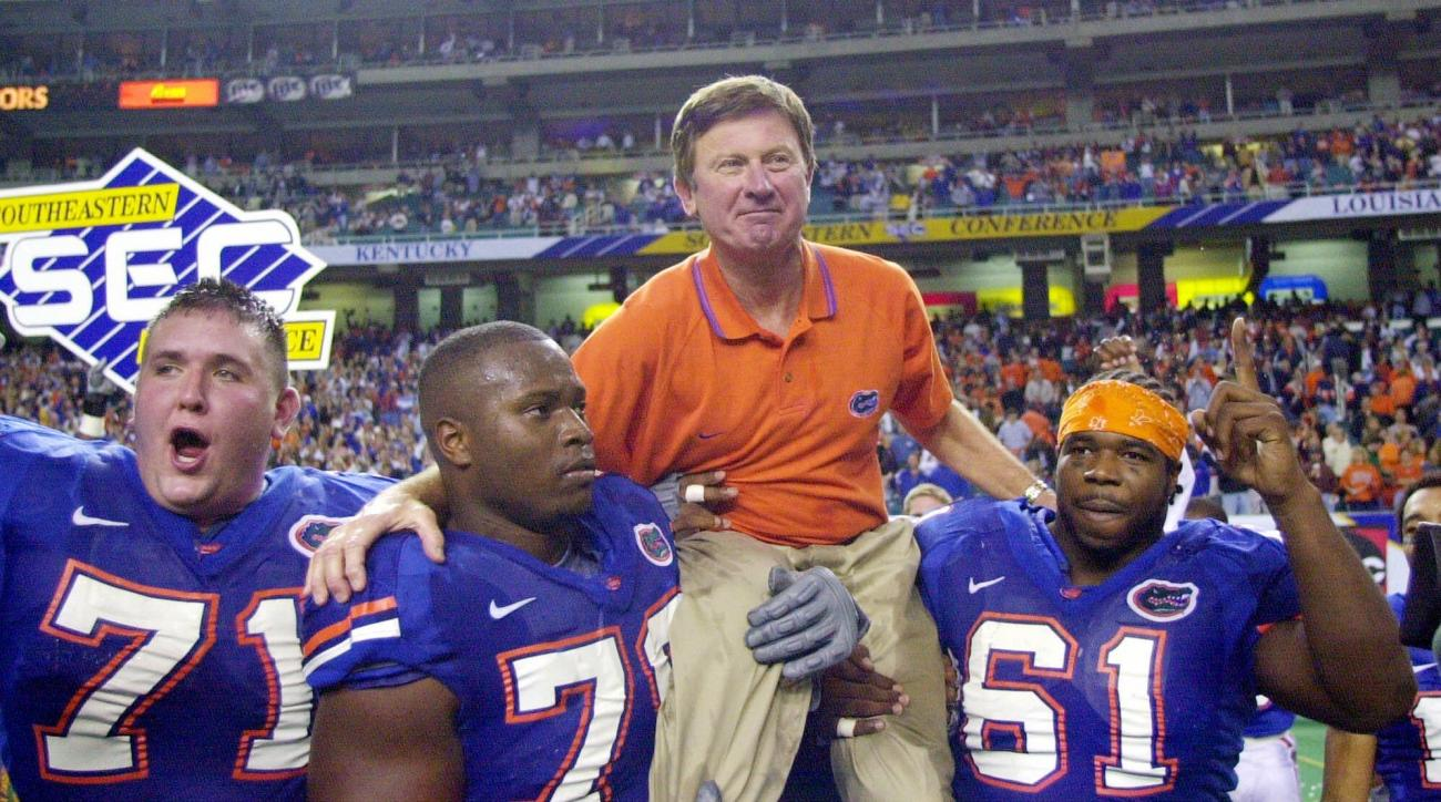 FILE - In this Dec. 2, 2000, file photo, Florida head coach Steve Spurrier is carried off the field after the Gators downed Auburn 28-6 in the SEC Championship at the Georgia Done in Atlanta. Players from left are  by Mike Pearson (71), Kenyatta Walker (7