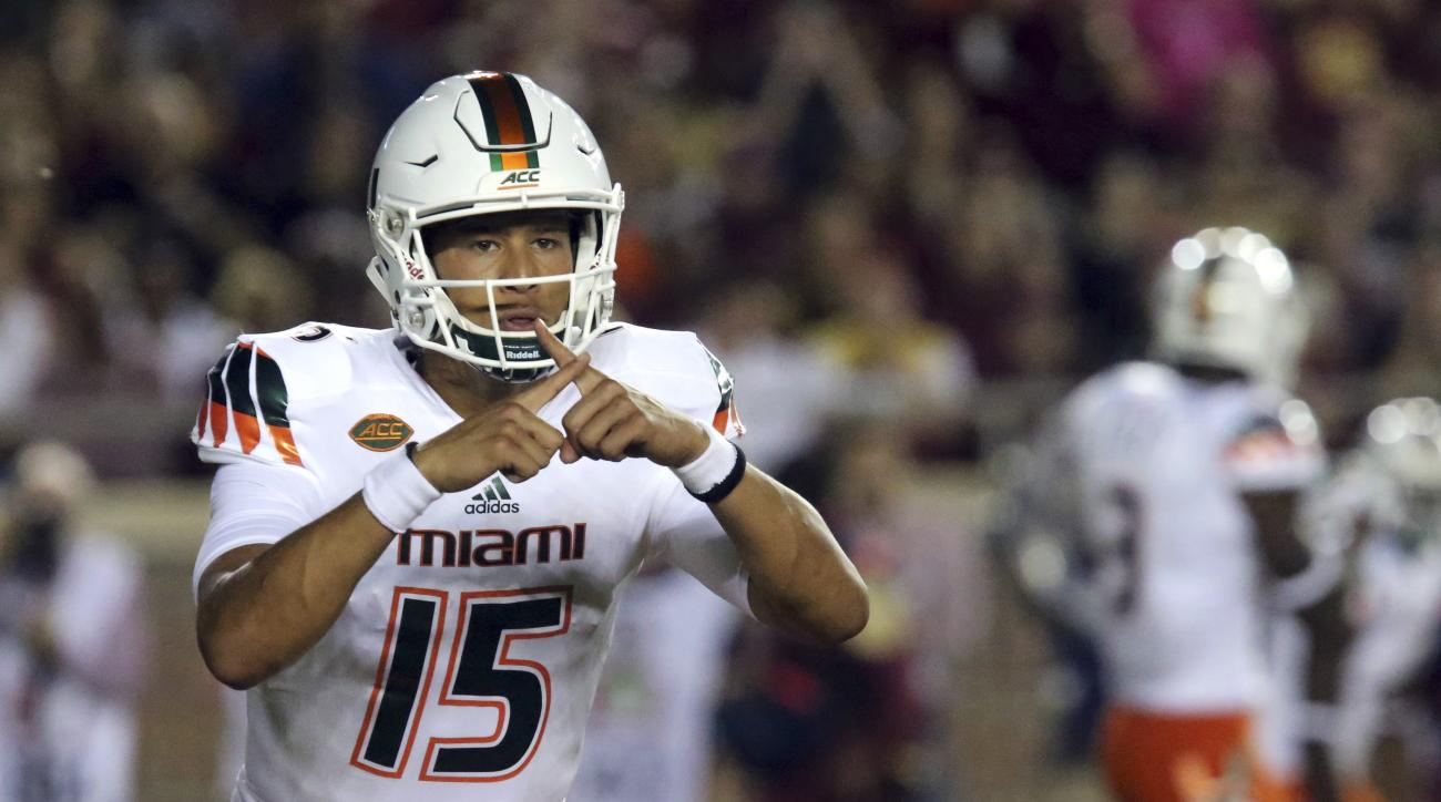 FILE - In this Oct. 10, 2015, file photo, Miami quarterback Brad Kaaya calls a play during an NCAA college football game against Florida State in Tallahassee, Fla. The Hurricanes have new coach in Mark Richt and are a decade removed from their last bowl w