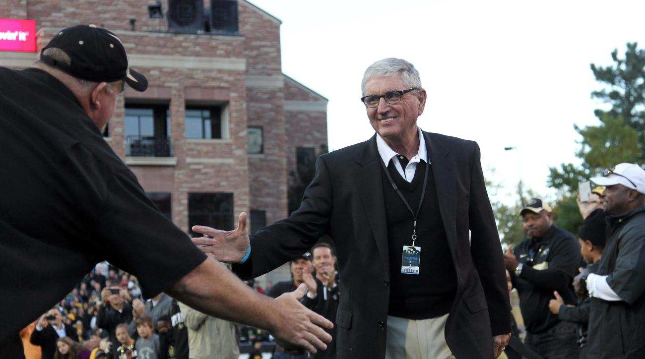 Retired Colorado head coach Bill McCartney, right, who was being honored for being inducted into the College Football Hall of Fame, is congratulated by former players during a ceremony at halftime of Oregon's 57-16 victory over Colorado in an NCAA college