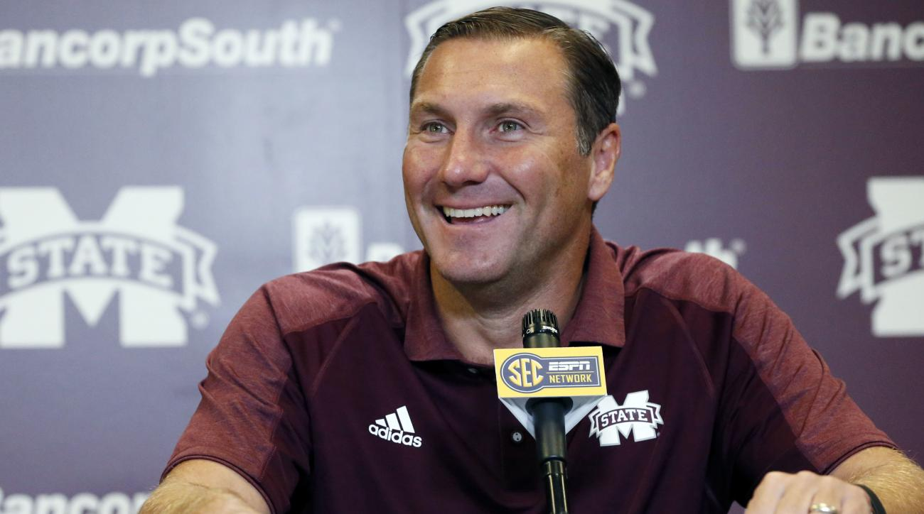 Mississippi State football coach Dan Mullen smiles at a reporter's question about the upcoming season during NCAA college football media day, Monday, Aug. 1, 2016, in Starkville, Miss. (AP Photo/Rogelio V. Solis)